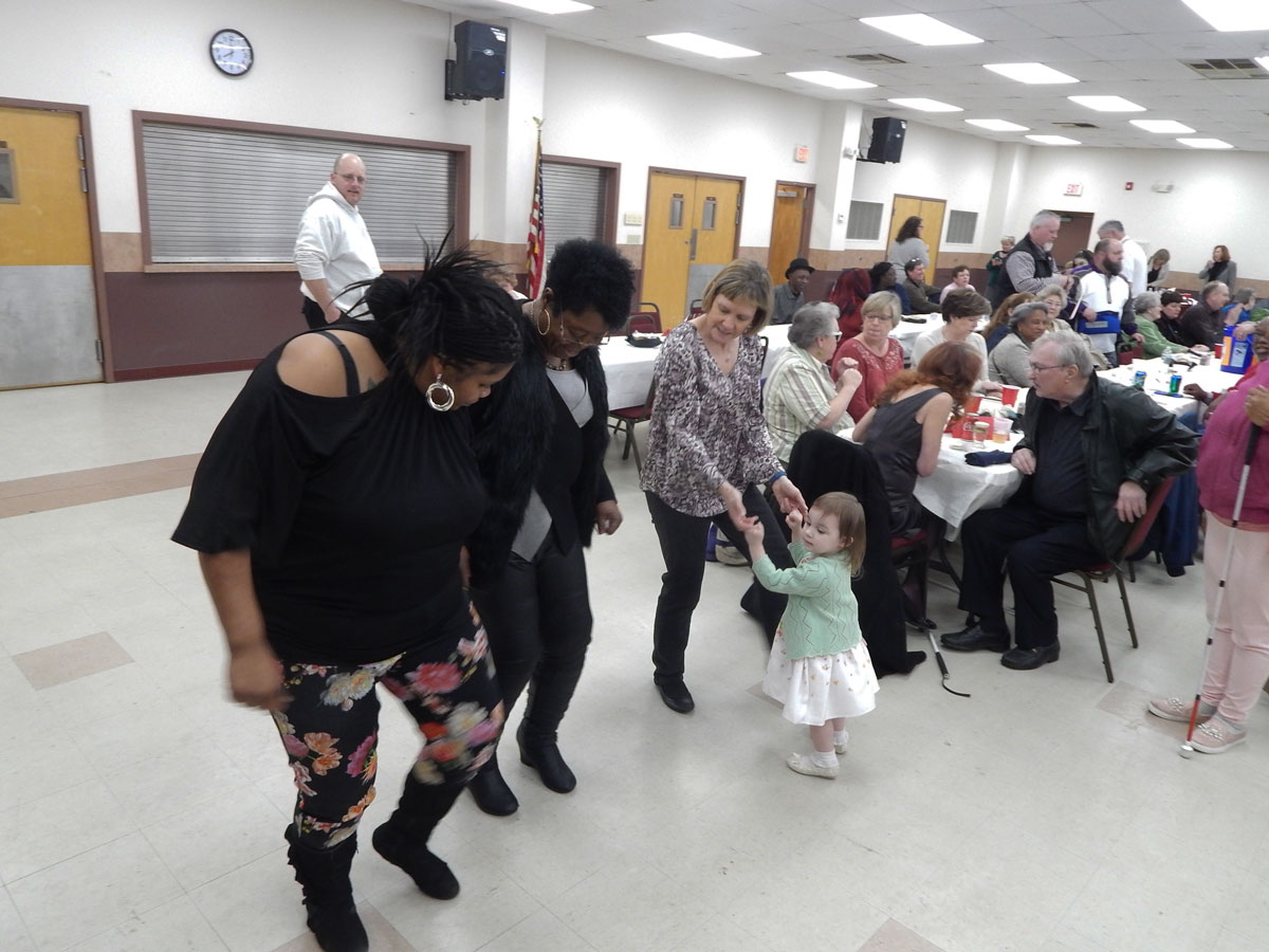 Salisbury staff dancing, Amy Crouse dancing with child