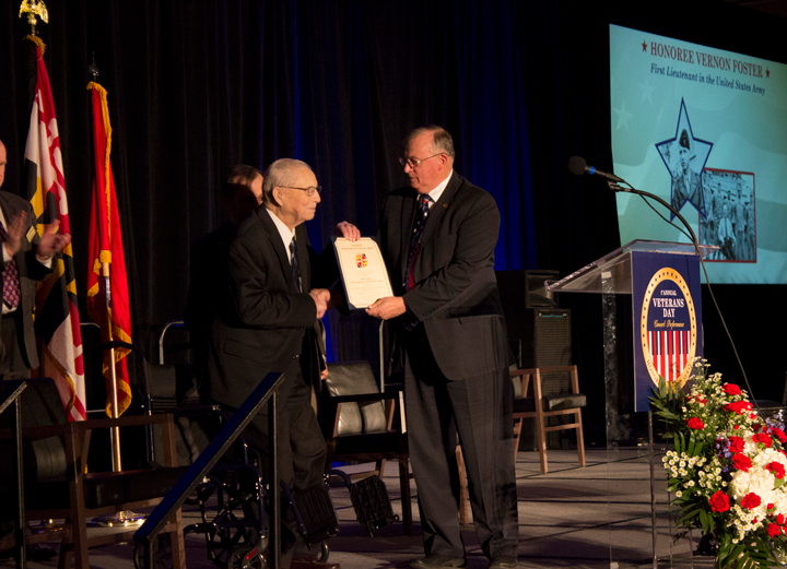 honoree receiving award from Veterans Affairs official