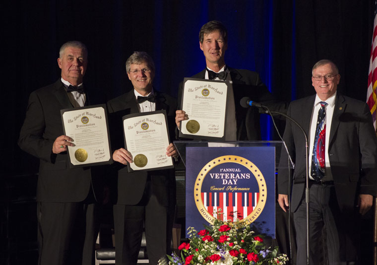 presidents of all three benefiting organizations displaying the proclamation given to them by the State of Maryland