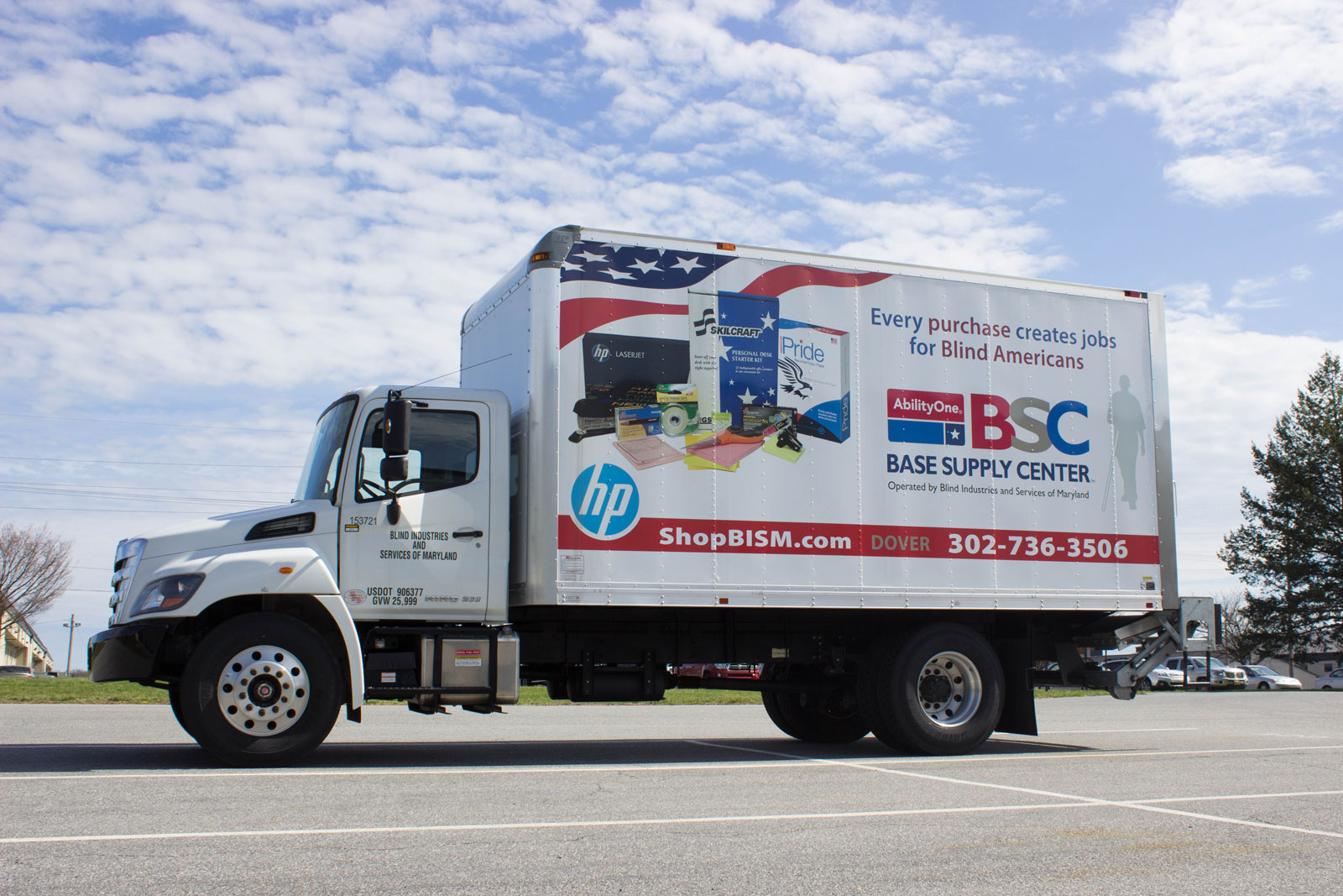 Box truck with BSC logo and product display on side