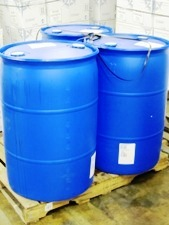 3 bright blue 55 gallon drums on pallet
