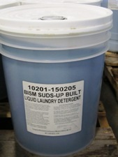 clear bucket, white lid, blue liquid, white label