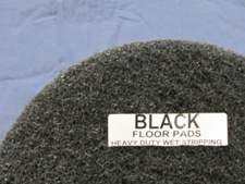 top half of black floor pad, label displayed