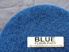 top half of blue floor pad, label displayed