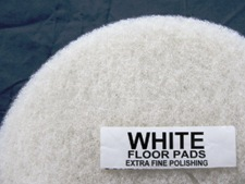 top half of white floor pad, label displayed