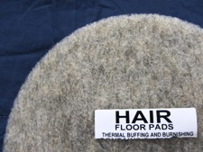 top half of natural hair floor pad, label displayed