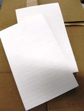 large paper pad, ruled white, no branding