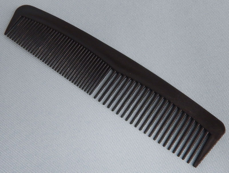 black plastic short comb
