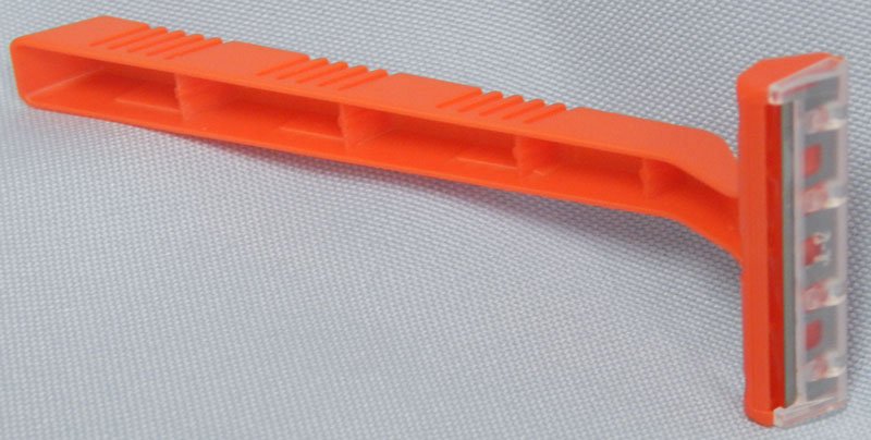 orange plastic handle single blade razor
