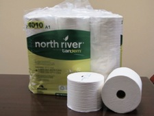 Pack of toilet paper with North River branding wrap, 2 loose rolls in front