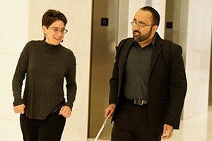 Amir Rahimi walking with coworker