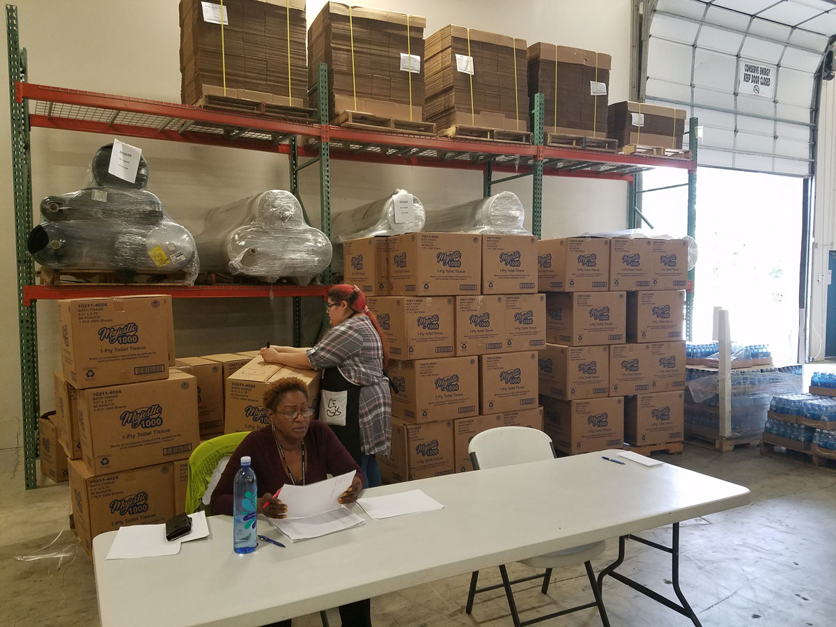 Toilet paper & bottled water being distributed to BISM Raleigh associates